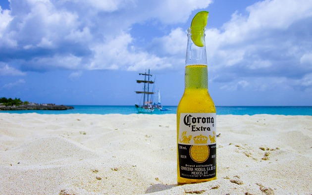 Bottle Of Beer In The Sand Looking Out To Sea.jpg